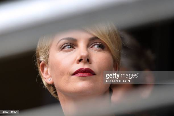 South African actress Charlize Theron attends the memorial service of South African former president Nelson Mandela at the FNB Stadium in...