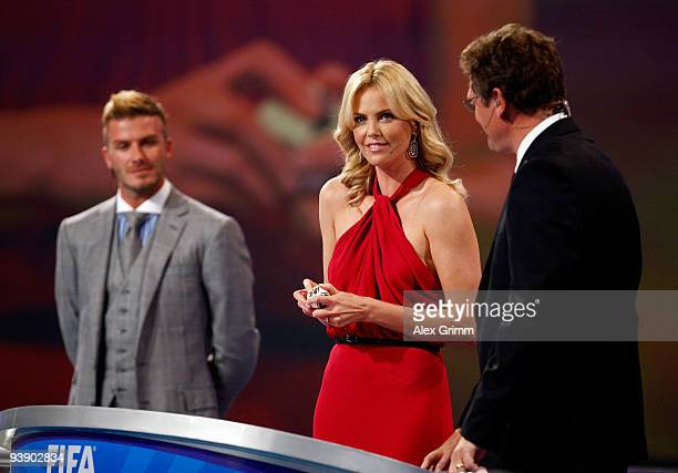South African actress Charlize Theron helps present the Final Draw for the FIFA World Cup 2010 December 4 2009 watched by David Beckham at the...