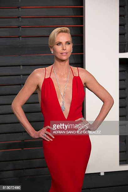 South African actress Charlize Theron poses as she arrives to the 2016 Vanity Fair Oscar Party in Beverly Hills California on February 28 2016 / AFP...