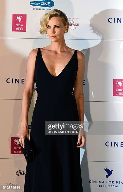 South African actress Charlize Theron poses for photographers as she arrives for the Cinema for Peace at the Konzerthaus in Berlin on February 15 on...