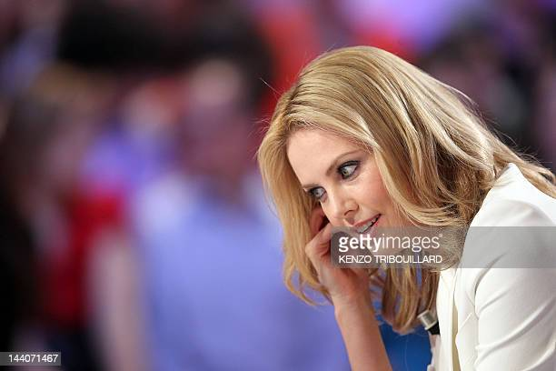 South African actress Charlize Theron takes part in the TV show Le grand journal on a set of French TV Canal on May 9 2012 in Paris to present her...