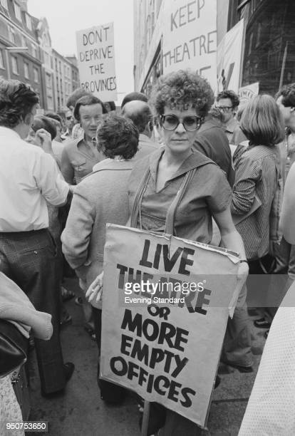 South African actress Janet Suzman at a demonstration in favor of the live theater industry London UK 11th July 1977 She is holding a placard which...
