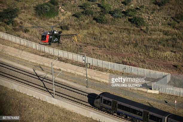 A South African airforce French made Aerospatiale Alouette II Helicopter races with the Gautrain to promote the upcoming South African Airforce...