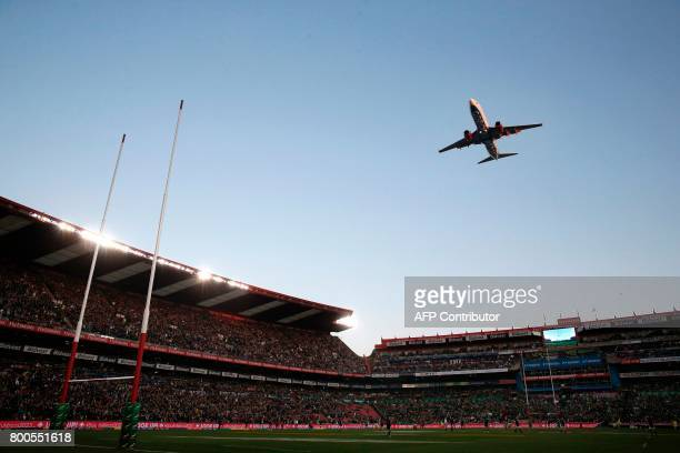 South African Airways aircraft flies over the pitch ahead of the third rugby union Test match between South Africa and France at The Emirates Ellis...