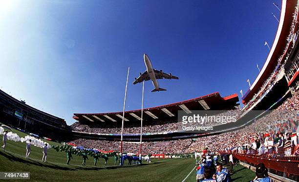 South African Airways jumbo jet with the slogan 'Good Luck Bokkie' flys over the stadium before the 1995 Rugby World Cup Final between South Africa...