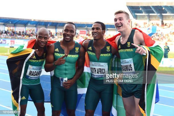 South African Akani Simbine gestures with his team mates after winning gold in the Men's 4 × 100 relay celebrate during the 21st African Senior...
