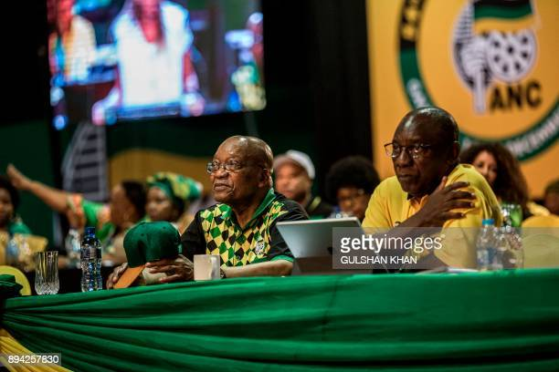 South African and African National Congress President Jacob Zuma sits on stage flanked by Deputy President Cyril Ramaphosa during a plenary meeting...