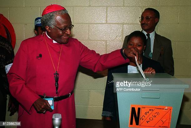 South African Anglican archbishop Desmond Tutu casts his vote 27 April 1994 in Guguletu Cape Town in South Africa's first democratic elections Tutu...