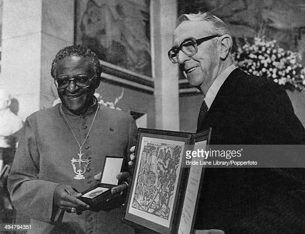 South African Anglican Archbishop Desmond Tutu receives the Nobel Peace Prize for his campaigning work against the apartheid regime in South Africa...
