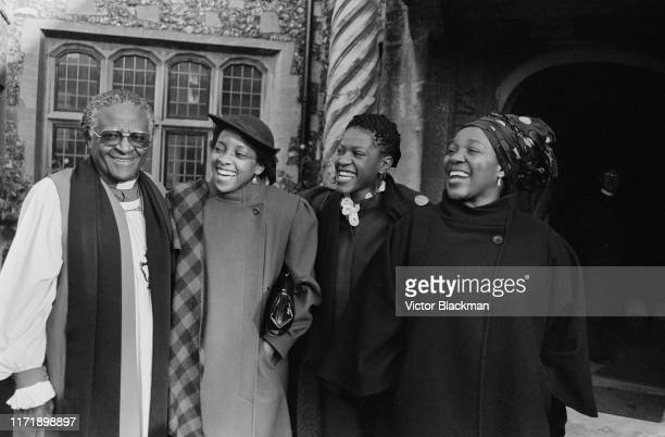 South African Anglican cleric theologian and antiapartheid and human rights activist Desmond Tutu with his wife Nomalizo Leah Tutu and other members...