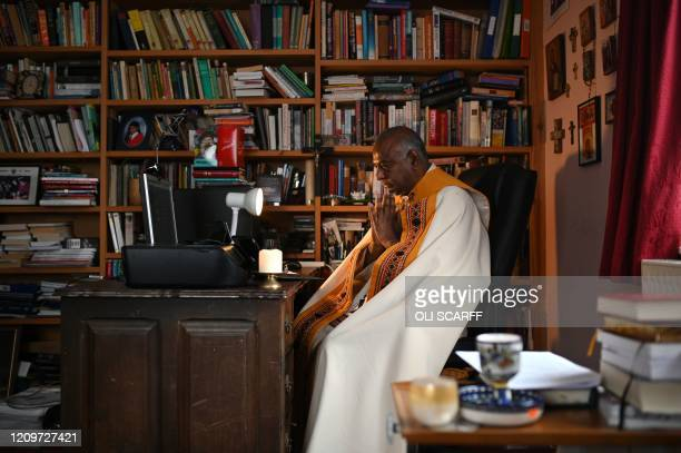 South African Anglican priest the Very Reverend Rogers Govender the Anglican Dean of Manchester prepares to deliver his Easter Sunday prayer and...