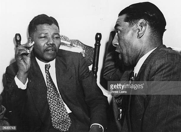 South African antiapartheid activist Nelson Mandela of the African National Congress in discussion with C Andrews a Cape Town teacher circa 1950