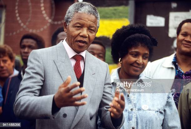 South African antiapartheid activist Nelson Mandela speaks with members of the press and students outside his home Soweto Johannesburg South Africa...