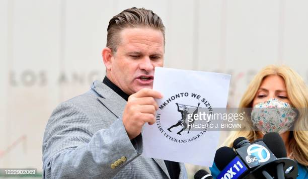 South African anti-apartheid activist/author Bradley Steyn addresses the media with attorney Lisa Bloom by his side during a press conference outside...