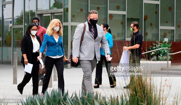 South African anti-apartheid activist/author Bradley Steyn is followed by attorney Lisa Bloom on arrival for a press conference outside the Los...