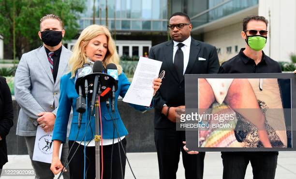 South African anti-apartheid activist/author Bradley Steyn looks on as attorney Lisa Bloom addresses the media during a press conference outside the...
