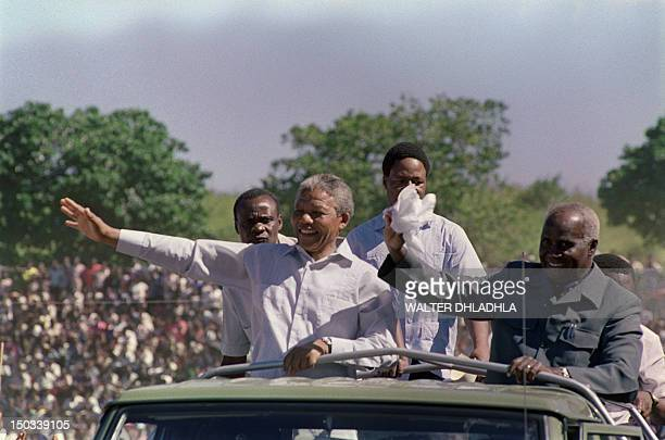 South African antiapartheid leader and African National Congress member Nelson Mandela and Zambian president Kenneth Kaunda wave to the crowd as they...