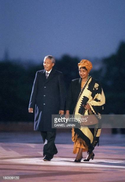 South African antiapartheid leader and African National Congress member Nelson Mandela flanked by his wife antiapartheid campaigner Winnie attends a...