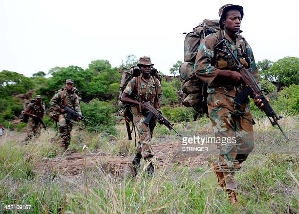 South African antipoaching task team patrol in Kruger National Park on November 26 2013 South African conservation authorities on November 26 said...