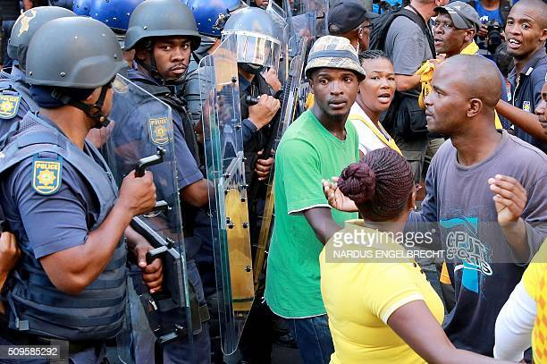 South African antiriot police officers clash with supporters of South Africa's President Jacob Zuma before his state of the nation address on...