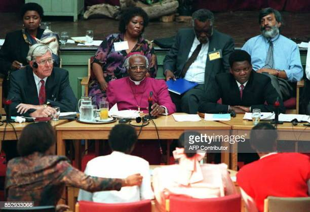 South African Archbishop Desmond Tutu with fellow commissioners listen to testamony from witnesses during the start of the Truth and Reconciliation...