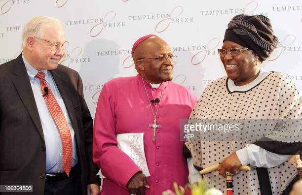 South African Archibishop Desmond Tutu flanked by his wife Leah Tutu and an Americanborn British investor Banker fund manager and philanthropist John...