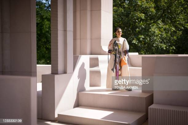 South African architect and founder of Johannesburg-based architectural studio Counterspace, Sumayya Vally, poses with the 20th Serpentine Pavilion,...