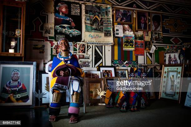 South African artist Esther Mahlangu poses at her home in Mabhoko Village Siyabuswa Mpumalanga on March 6 2017 Mahlangu recently opened her...
