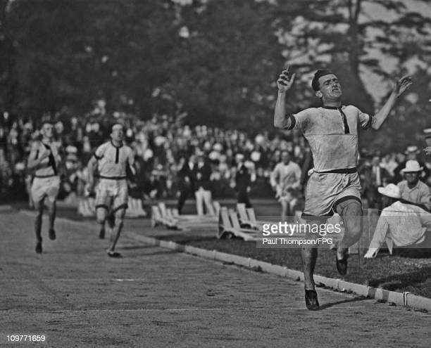 South African athlete Bevil Rudd winning an 800 metre race circa 1920.