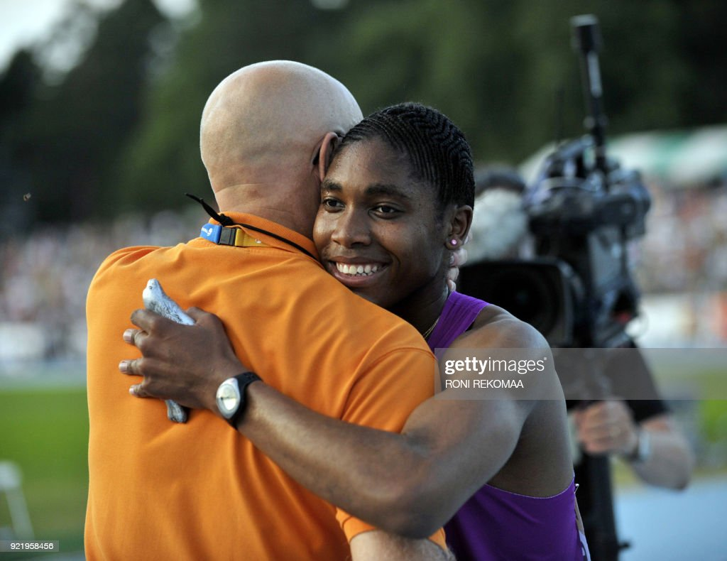 South African athlete Caster Semenya (R) gets a hug from her manager, Finnish Jukka Harkonen, in Lappeenranta, Eastern Finland on July 15, 2010 for her first start since the Berlin World Championships last year. Semenya's gender was under investigation after the Berlin 2009, where she won women's 800m gold. Semenya took part in the Lappeenranta Games today, where she won the women's 800m race. AFP PHOTO/ LEHTIKUVA/ RONI REKOMAA / AFP PHOTO / LEHTIKUVA / Roni Rekomaa
