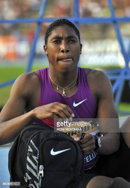 South African athlete Caster Semenya sticks out her tongue as she gets ready prior to compete in Lappeenranta Eastern Finland on July 15 2010 for her...