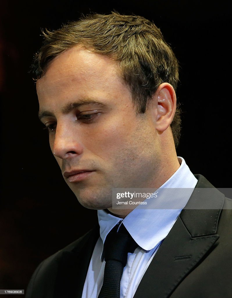 South African athlete Oscar Pistorius appears in Pretoria Magistrates Court for an indictment hearing on August 19, 2013 in Pretoria, South Africa. Pistorius, 26 is accused of murdering his girlfriend Reeva Steenkamp which Pistorius denies claiming he mistook Steenkamp for an intruder. The indictment was served and the trial date of March 3, 2014 has now been set.
