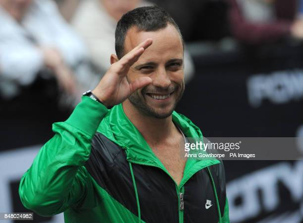South African athlete Oscar Pistorius waves to the crowd during the Great CityGames on Deansgate Manchester