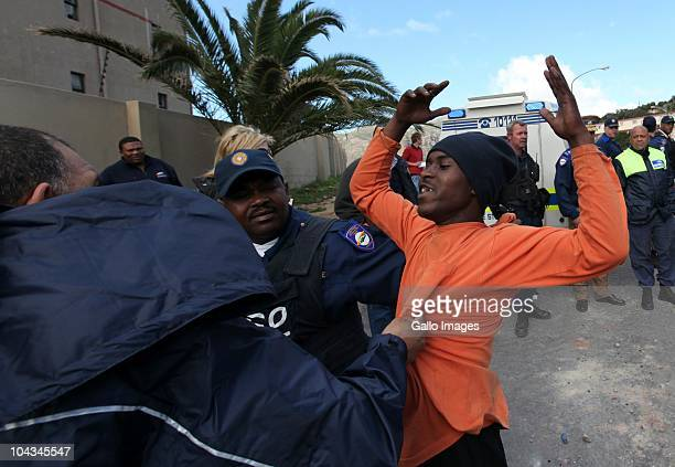 South African authorities arrest residents of Hangberg after violence broke out in Hout Bay near Cape Town South Africa on 21 September 2010 when...