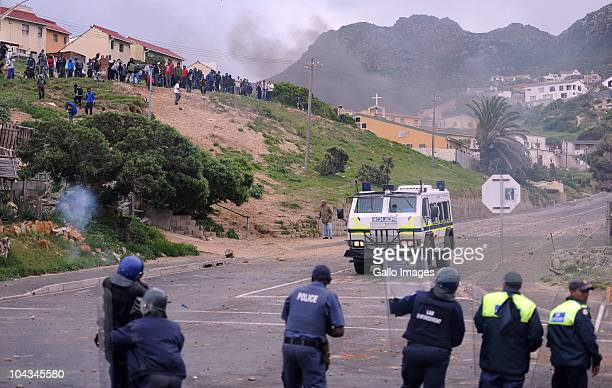 South African authorities shoot rubber bullets at residents of the informal settlement Hangberg after violence broke out in Hout Bay near Cape Town...