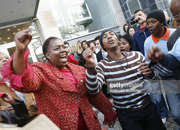 South African axed Health deputy minister Nozizwe MadlalaRoutledge sings and dances 10 August 2007 with TAC activists after giving a press conference...