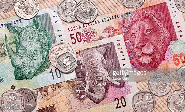 south african banknotes and coins. - south african currency stock photos and pictures