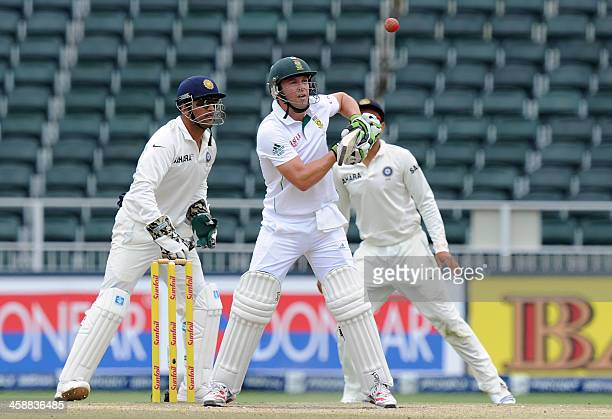 South African batsman AB de Villiers blocks a shot from Indian bowler Ravichandran Ashwin on the 5th day of a first cricket Test match between South...