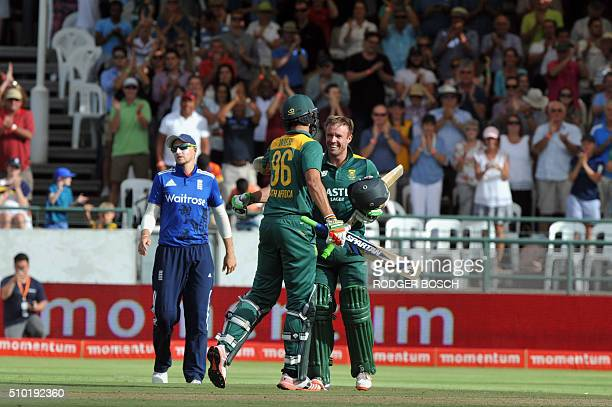 South African batsman AB de VIlliers is congratulated by teammate David Wiese after DeVilliers reached his century during 5th and final One Day...