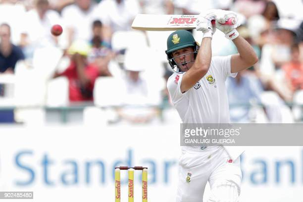 South African batsman AB de Villiers plays a shot during the fourth day of the first Test cricket match between South Africa and India at Newlands...