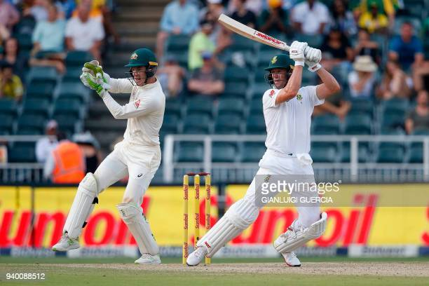 South African batsman AB de Villiers plays a shot on the first day of the fourth Test cricket match between South Africa and Australia at Wanderers...
