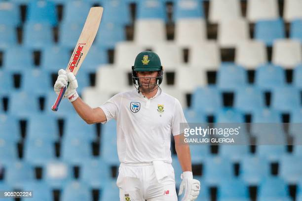 South African batsman AB de Villiers raises his bat as he celebrates after scoring half century during the third day of the second Test cricket match...