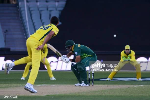 South African batsman Aiden Markram ducks a ball from Australia's Mitchell Starc during the second one day international cricket match between...