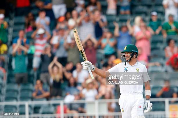 South African batsman Aiden Markram raises his bata as he celebrates scoring 150 runs on the first day of the fourth Test cricket match between South...