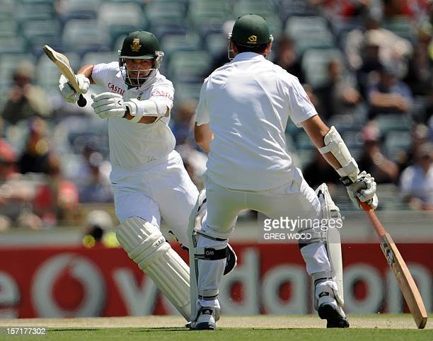 South African batsman Alviro Petersen avoids teammate Graeme Smith while taking a run on day one of the third cricket Test between South Africa and...