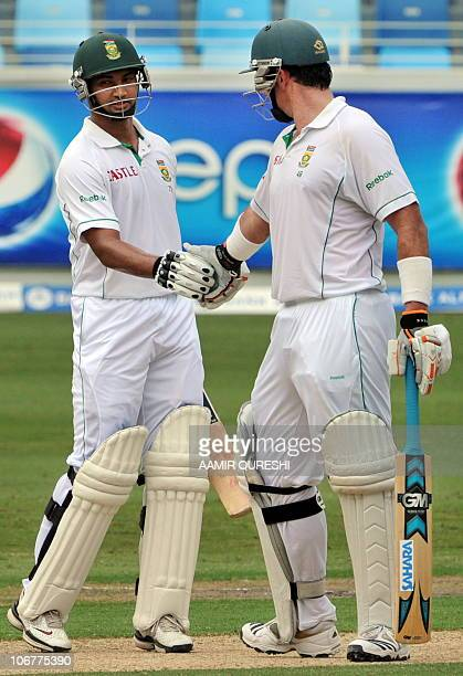 South African batsman Alviro Peterson shakes hands with team captain Graeme Smith after scoring 50 runs against Pakistan during the first Test match...