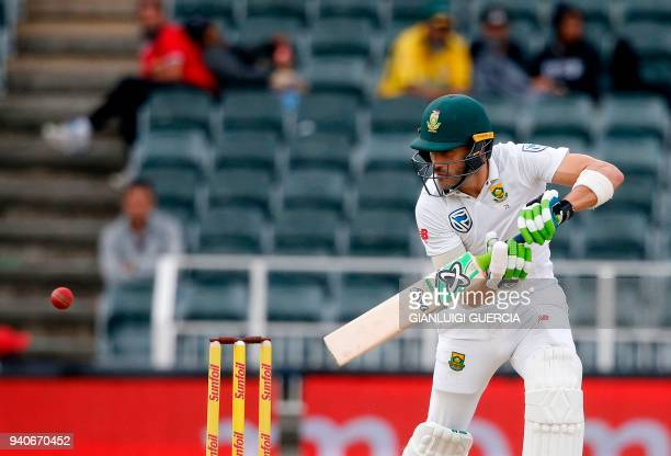 South African batsman and captain Faf du Plessis plays a shot on the third day of the fourth Test cricket match between South Africa and Australia at...