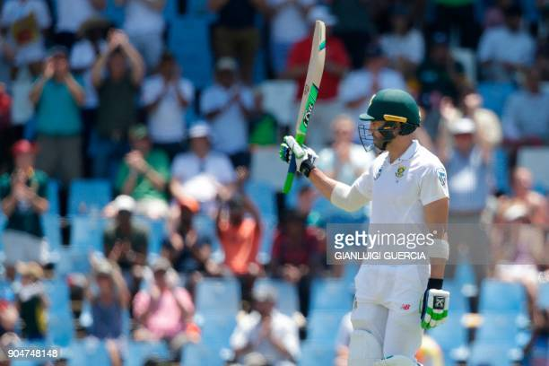 South African batsman and Captain Faf du Plessis raises his bat as he celebrates scoring a halfcentury during the second day of the second Test...