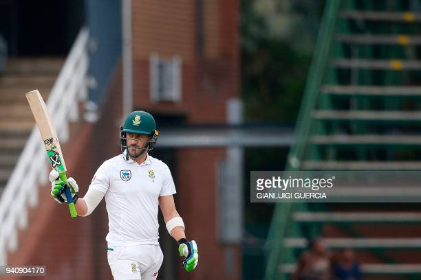 South African batsman and Captain Faf du Plessis raises his bat as he celebrates scoring half century on the fourth day of the fourth Test cricket...