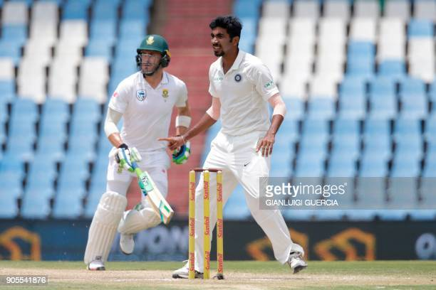 South African batsman and Captain Faf du Plessis takes a run as Indian bowler Jasprit Bumrah looks on during the fourth day of the second Test...